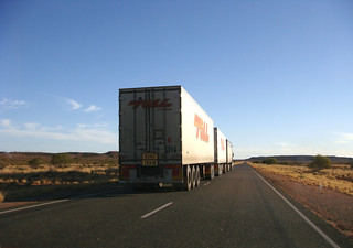 Triple-trailer road train on the Australian outback