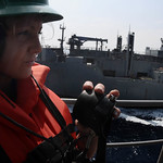 Sailor stands phone-talker watch aboard USS Bataan during a replenishment at sea