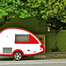 Red and white travel trailer by 2composers