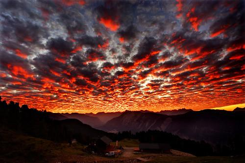 sunset red sun mountains alps rot clouds geotagged austria tirol österreich long sonnenuntergang pentax wolken sigma explore sonne frontpage 2009 coordinates hdr tyrol position lat 10mm 3xp photomatix sigma1020 k200d traumlicht traumlichtfabrik adopeeddishop