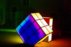 glass(0.0), design(0.0), rubik's cube(1.0), symmetry(1.0), yellow(1.0), light(1.0), darkness(1.0), mechanical puzzle(1.0), lighting(1.0), toy(1.0),