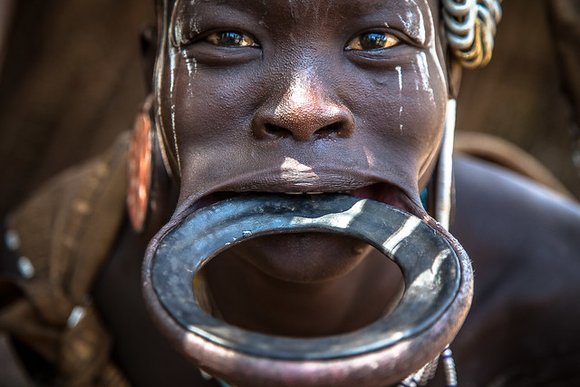 woman with traditional lip plate, Mursi tribe, omo valley, ethiopia