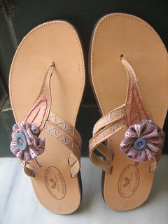 Leather sandals decorated with buttons, embroidery and handwoven elements