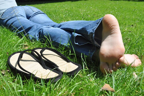 Laying Barefoot In The Grass by Artistic Feet