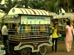 rickshaw(0.0), fair(0.0), cart(0.0), vehicle(1.0), stall(1.0), street food(1.0), food(1.0),