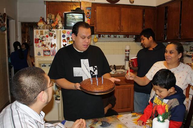 Mom Lighting Birthday Cake