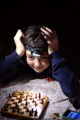olivia playing chess by headlamp    MG 4661