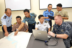 SINGAPORE  (June 15, 2011)  Cmdr. Troy Amundson (far right), Deputy for Operations at Commander, Task Force 73, joins liasion officers from (left to right) Brunei, Thailand, Indonesia, Singapore, Malaysia and the Philippines participating in Southeast Asia Cooperation Cooperation Against Terrorism (SEACAT) for training at Singapore's Changi Naval Base. (Photo courtesy of the Singapore Ministry of Defense)