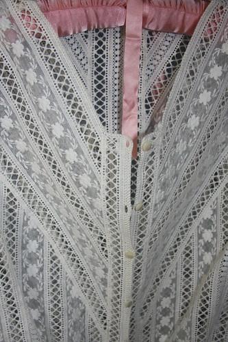 Lace insert blouse buttonholes