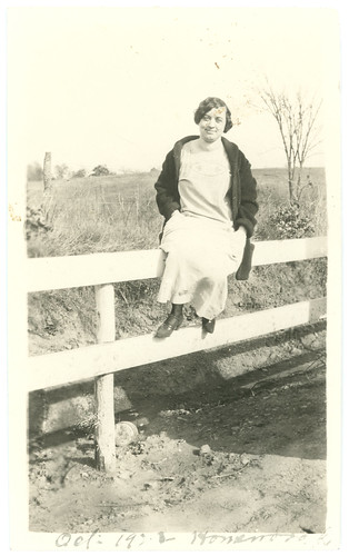 Woman on Fence