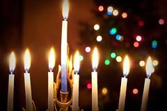 christmas decoration(0.0), lighting(0.0), candle(1.0), light(1.0), hanukkah(1.0), christmas(1.0), darkness(1.0), night(1.0),