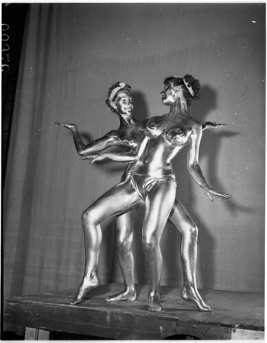 Parisian Moon Dancers in gold paint at the Palladium Theatre, Sydney, 28 September 1955 / Ern McQuillan