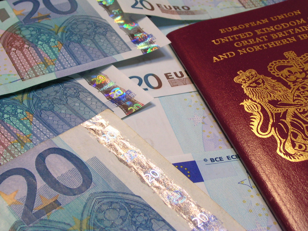 Closeup of UK passport and Euro notes