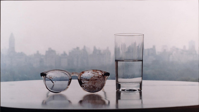 Season of Glass, 1981, John Lennon's blood covered glasses from his assassination, placed on a table with a glass of water, taken in his Dakota apartment overlooking New York's Central park, by Yoko Ono