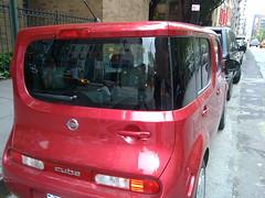 automobile(1.0), automotive exterior(1.0), vehicle(1.0), nissan cube(1.0), compact sport utility vehicle(1.0), microvan(1.0), nissan(1.0), bumper(1.0), land vehicle(1.0),