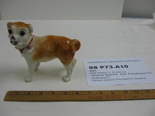 Medium sized pug dog porcelain figurine in a standing pose, circa 1900