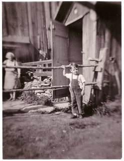 Little boy in barn yard