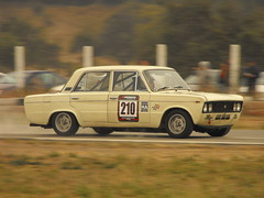 bmw 2002tii(0.0), auto racing(1.0), automobile(1.0), family car(1.0), vehicle(1.0), seat 1430(1.0), bmw new class(1.0), compact car(1.0), antique car(1.0), sedan(1.0), land vehicle(1.0),