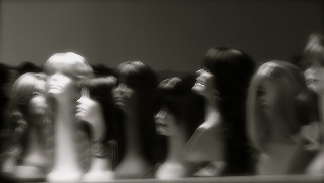 Wig store mannequins after closing time at a wig shop