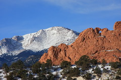 Pikes Peak Mountain, Kissing Camels red rocks in the foreground, Garden of the Gods Park in Colorado Springs, CO USA, America the Beautiful