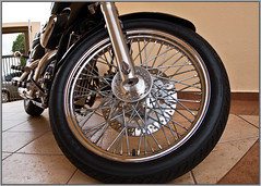 bicycle wheel(0.0), bicycle(0.0), tire(1.0), automotive tire(1.0), wheel(1.0), vehicle(1.0), motorcycle(1.0), rim(1.0), chopper(1.0), alloy wheel(1.0), spoke(1.0),