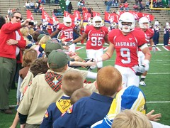 football team high fives boy scouts