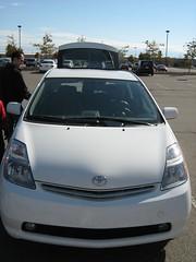 automobile(1.0), automotive exterior(1.0), vehicle(1.0), compact car(1.0), bumper(1.0), toyota prius(1.0), land vehicle(1.0),