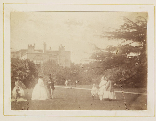 People in gardens of unidentified house