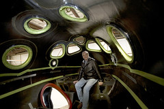 Burt Rutan inside the spacious SpaceShipTwo cabin. Scaled Composites, Mojave, CA. Credit Mark Greenerg