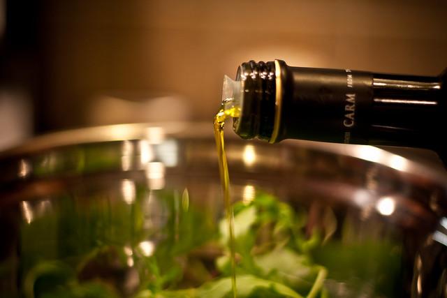 Olive oil on aragula