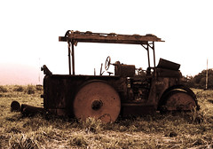 crop(0.0), bulldozer(0.0), harvester(0.0), agriculture(1.0), farm(1.0), field(1.0), soil(1.0), vehicle(1.0), transport(1.0), agricultural machinery(1.0), construction equipment(1.0), land vehicle(1.0), rural area(1.0), tractor(1.0),