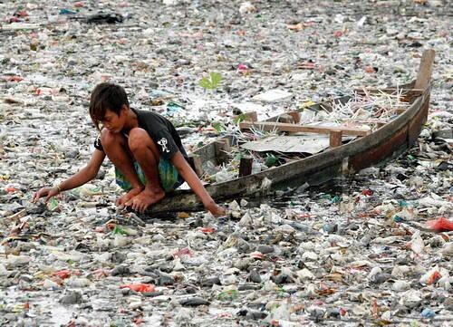 This picture is scary. The boy is on a boat, in a river that is completely filled with plastic trash. Can you believe there are places in our world like this? Change Agent Anna Cummins and her hubby Marcus are tackling the issue of plastic pollution in our world's waterways and oceans!