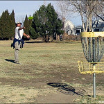 Eric Cunningham reaches for the basket on hole #13 Pueblo City Park.