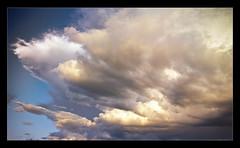 cumulus(1.0), cloud(1.0), sunlight(1.0), daytime(1.0), sky(1.0),