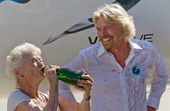 Sir Richard Branson and his mother Eve celebrate the roll out of WhiteKnightTwo, named VMS Eve after her. Credit Herb Lingl