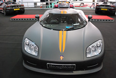koenigsegg cc8s(0.0), race car(1.0), automobile(1.0), vehicle(1.0), performance car(1.0), automotive design(1.0), koenigsegg ccr(1.0), land vehicle(1.0), supercar(1.0), sports car(1.0),