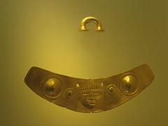 lamp(0.0), light fixture(0.0), sconce(0.0), yellow(1.0), metal(1.0), light(1.0), amber(1.0), circle(1.0), lighting(1.0), brass(1.0),
