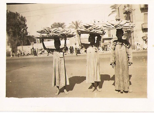 Egypt 1940s- they must be vendors of some sort of bread?
