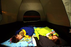 reunited brothers sleeping in the tent together    M…