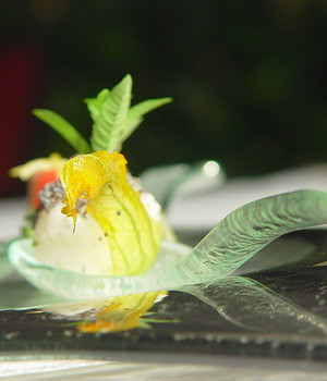 Small spoon shaped glass dish for canapé and  amuse bouche fine dining presentation