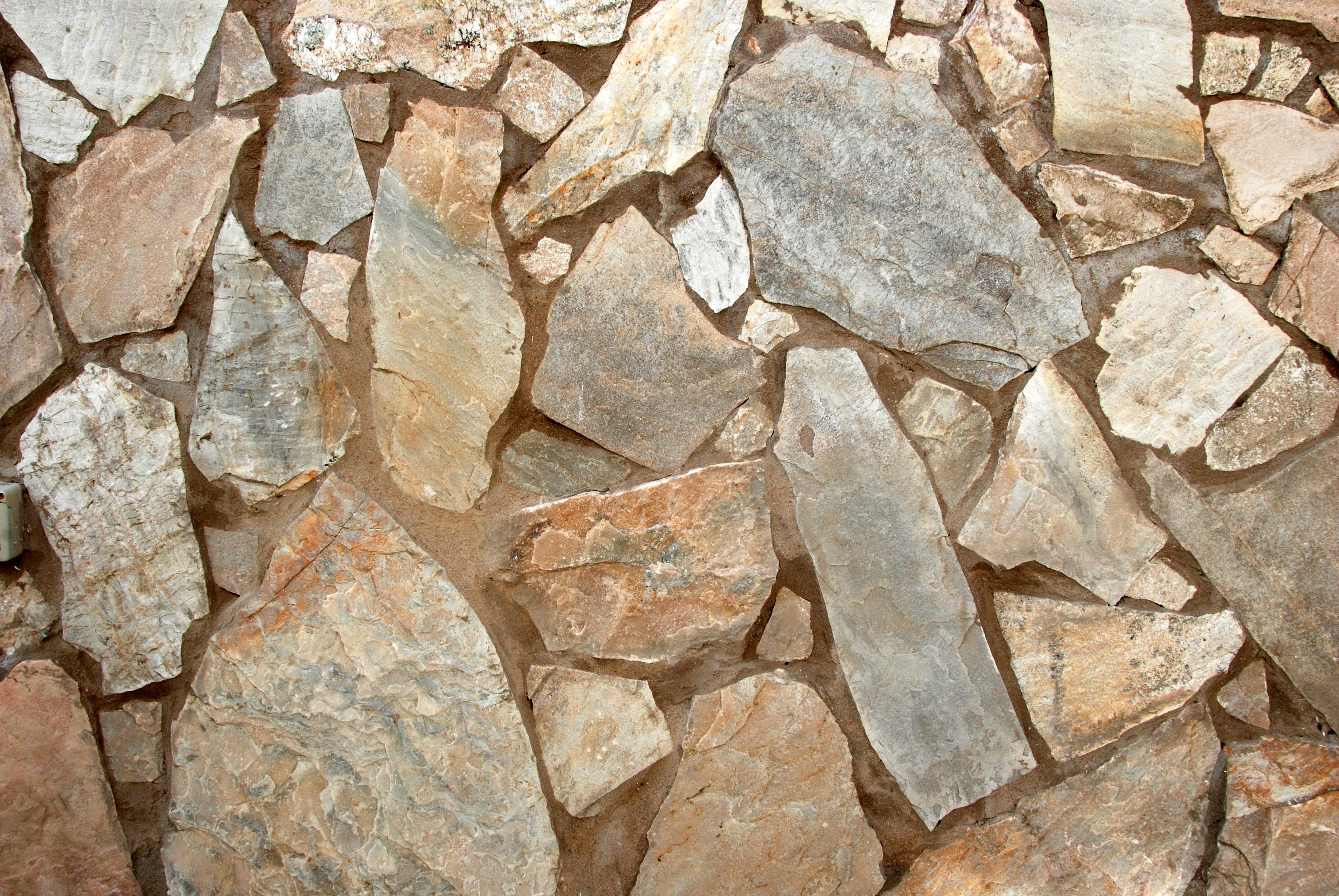 Pared piedras y cemento canarias creativa - Piedras para pared ...