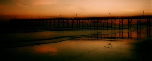 ocean sunset red sea sky reflection film beach analog 35mm pier nc sand surf waves dusk northcarolina scan atlantic processed orton fishingpier atlanticbeach crystalcoast dphdr shotwithacrappydisposableadvantixpanoramiccamera