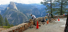 Half Dome from Glacier Point panorama with workers rebuilding rock wall
