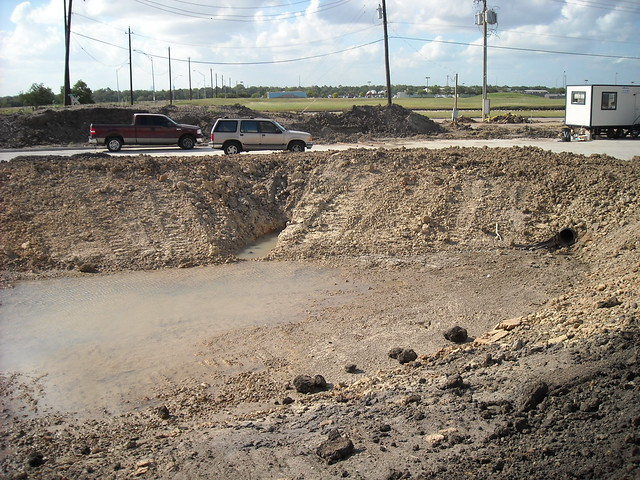 Site work detention pond and storm drainage for concrete for Concrete pond construction