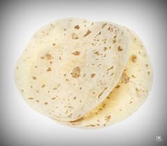 bread(0.0), pupusa(0.0), baked goods(0.0), ciabatta(0.0), naan(0.0), bazlama(0.0), flatbread(1.0), tortilla(1.0), food(1.0), piadina(1.0), roti(1.0), cuisine(1.0), chapati(1.0),