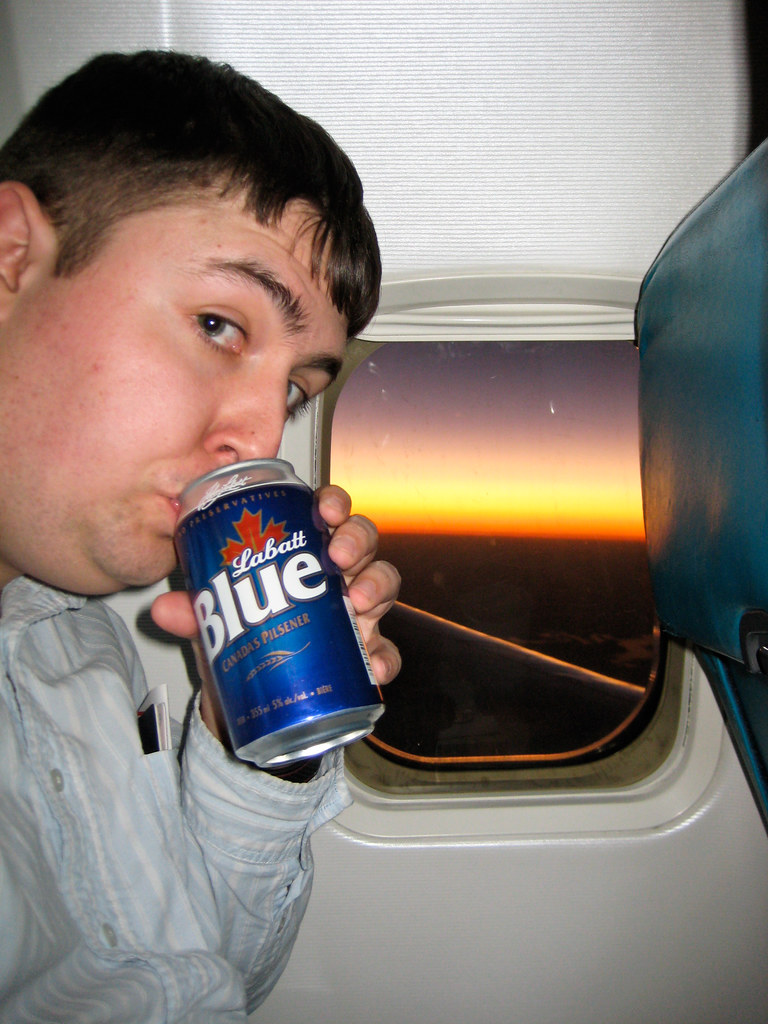 Enjoying a beer on a plane