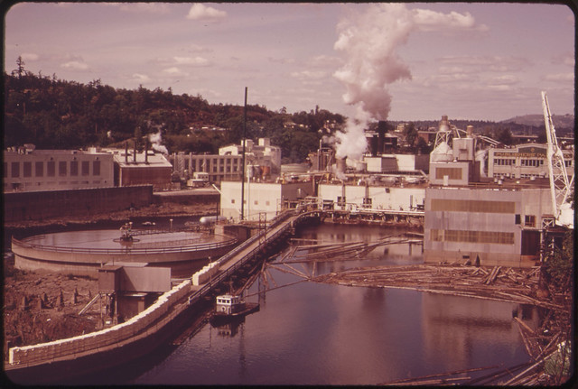 DOCUMERICA: Publisher's Paper Company at Oregon City, on the Willamette River. Together with Crown-Zellerbach Corporation, This Company Led a Successful Campaign to Clean Up the River 04/1973 by David Falconer.