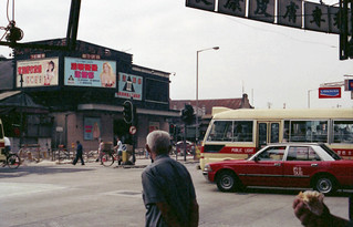 Street shot, note the ads with white women on the film markee, Kanloon, Hong Kong in 1990