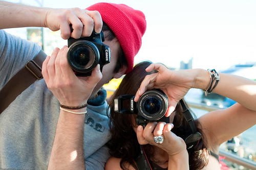 Two people taking photographs