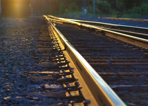 railroad sunset sun gold amber rivets shine steel olympus pins historic rails rays 2009 gravel goldenhour scottkelby niftyfifty e420 zuiko50mmf18 worldwidephotowalk